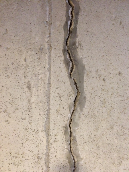A Large Crack in the Wall Before Sealing It.